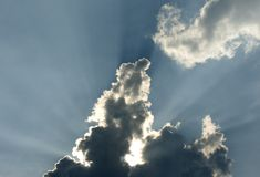 Sky. Blie sky with the sun behind the clouds Royalty Free Stock Photos
