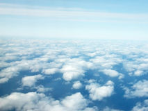 Sky from above. Aerial view of clear blue sky with cloud puffs Royalty Free Stock Photography