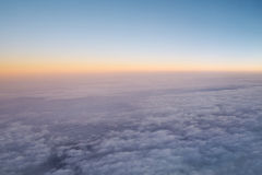 Sky above cloud. Sea cloud view from the window of an airplane Stock Photos