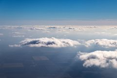 The sky above the clouds. View from airplane, blue, background, beautiful, beauty, heaven, nature, white, high, cloudscape, clear, natural, space, freedom stock photography
