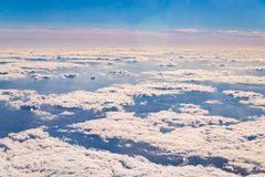 The sky above the clouds. View from airplane, blue, background, beautiful, beauty, heaven, nature, white, high, cloudscape, clear, natural, space, freedom royalty free stock image