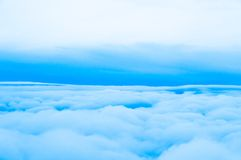 Sky Above Clouds. Clouds. view from the window of an airplane flying in the clouds Stock Image