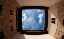 Sky above the courtyard of Alhambra palace in Gran. Sky above the moorish courtyard of Alhambra palace in Granada, Spain Stock Photography