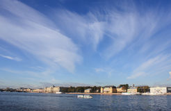 The sky above the Neva. View on embankment in Saint-Petersburg Royalty Free Stock Photos