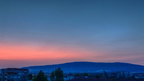 Before sunrise. The sky above Pustrina Mountain was magnificent with this pink color - just before the sunrise Stock Images