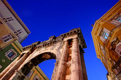 Sky above the Roman Arch of the Sergei in Pula. Arch of the Sergii is an Ancient Roman triumphal arch located in Pula, Croatia. approximate date of construction Royalty Free Stock Photo