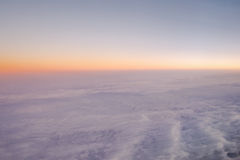 Sky above sea cloud. Sky above cloud, sea cloud view from the window of an airplane Stock Photo