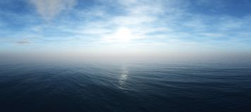 Beautiful sky with clouds and the sun above the sea royalty free stock photo