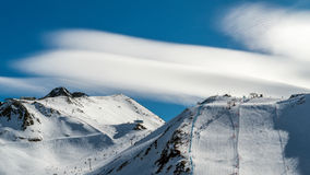 Sky above the ski slopes at Europe mountains. Sky of interesting form above the mountains at Europe in winter time Royalty Free Stock Image