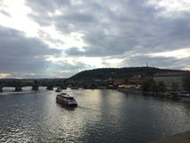 Sky above the Vltava river and Charles bridge in Prague stock photography