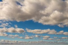 Sky of abundant white clouds and celestial spaces. Cottony clouds distributed throughout the sky. Water in the form of vapor royalty free stock photo
