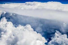 Through the sky abyss. Plane flying through the sky abyss Stock Images