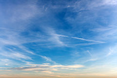 Sky with Airplane Exhaust Sreams Royalty Free Stock Photography
