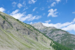 Sky in Alps. The peaks of the Italian Alps in Livigno stock photo