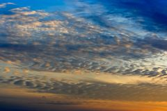 Sky and Altocumulus Clouds. An evening sky with altocumulus clouds Stock Images