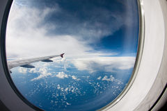 Sky as seen through window of an aircraft Stock Photos