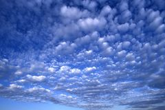 Sky Background. Wide view of cloudy blue sky to use as background or wallpaper Royalty Free Stock Images