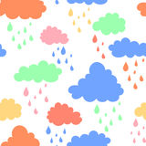 Sky background with blue, pink, green and orange clouds. Hand drawn seamless pattern. Vector illustration in cartoon. Style Stock Images