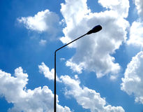 Sky. Background blue sky with small clouds. And poles located between the center of the image Stock Photo