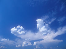 Sky background. Blue sky and white clouds. Useful as background for your projects Stock Photo