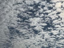 Sky background crowded with patches of clouds.Photo Image Stock Images