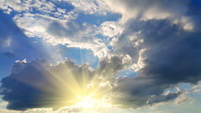 Sky background with dark clouds and sunlight Stock Photo