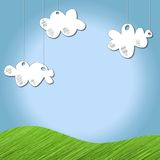 Sky background. With drawn clouds hanging from above and a bit of sketched grass Royalty Free Stock Images