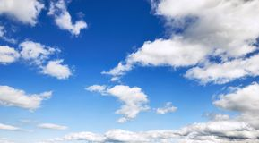 Sky background with fluffy clouds Stock Image