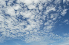 Sky background with the fluffy white clouds Stock Photography