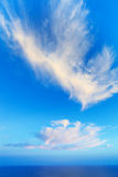 Sky background with a nice cloud over the sea. Blue sky and fluffy white cloud over the sea Stock Image
