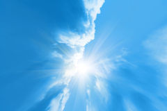 Sky background with sun beams. Blue sky background with clouds and sunlight Stock Images