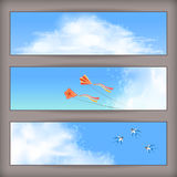 Sky banners: white clouds, flying kites, swallows Royalty Free Stock Image