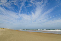 Sky beach. A dramatic blue sky converges with a wide, desolate beach Royalty Free Stock Photos