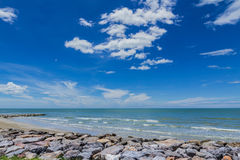 Sky with beautiful beach with rocks and tropical sea Royalty Free Stock Images