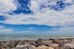 Sky with beautiful beach with rocks and tropical sea Stock Photography