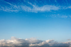 The sky. Beautiful blue sky with big clouds on the horizon and light Cirrus clouds Royalty Free Stock Photography