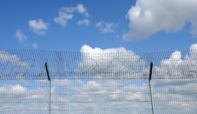 Sky behind the fence Royalty Free Stock Photo