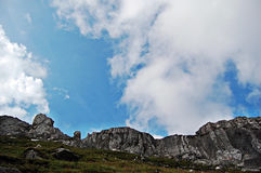 The sky behind the rocks. This image is placed in Bucegi Mountains, and presents a beatiful sky royalty free stock photos