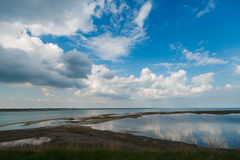 Sky and big clouds over firth with horizon line Royalty Free Stock Image