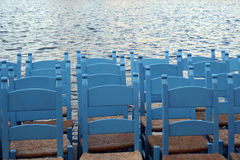 Sky blue chairs aligned on waterfront. Typical greek chairs new painted. Evening in Hania, Creete Royalty Free Stock Photos