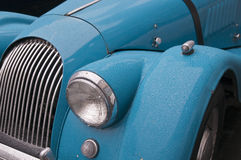 Sky blue classic sports car with raindrops Stock Photo