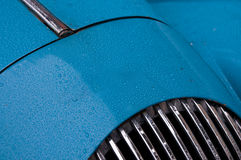 Sky blue classic sports car with raindrops Royalty Free Stock Image