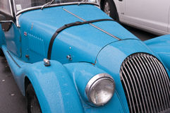 Sky blue classic sports car with raindrops Stock Image
