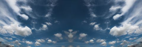 The sky is blue. And if regular clouds are white. royalty free stock images