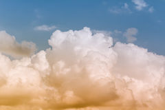 Sky. Blue sky with orange light on clouds Royalty Free Stock Image