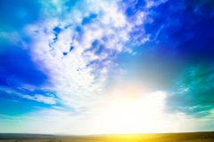 Sky. Blue sky background with purple and green clouds. Sky with clouds on sunset.  Royalty Free Stock Images