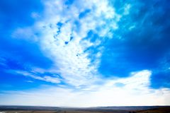 Sky. Blue sky background with purple and green clouds. Sky with clouds on sunset.  Royalty Free Stock Photography