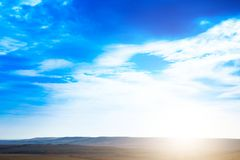 Sky. Blue sky background with purple and green clouds. Sky with clouds on sunset.  Stock Image