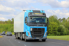 Sky Blue Volvo Truck in Traffic Stock Photos