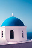 Sky blue white roof church sea Stock Images